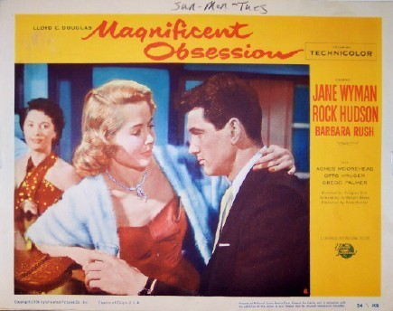 Pictured is a US lobby card for the 1954 Douglas Sirk film Magnificent Obsession starring Rock Hudson and Jane Wyman.