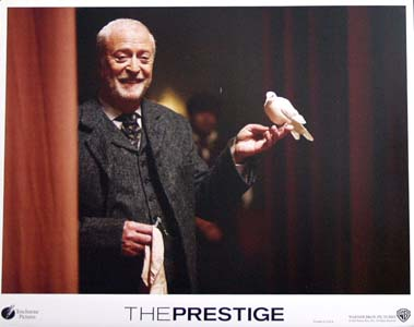 Pictured is a US promotional lobby card for the 2006 Christopher Nolan film The Prestige starring Hugh Jackman, Christian Bale and Michael Caine.