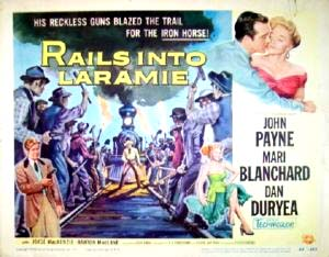 Pictured is a US lobby card  for the 1954 Jesse Hibbs film Rails into Laramie starring John Payne.