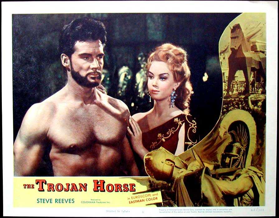 Pictured is a US lobby card for the 1962 Giorgio Ferroni film The Trojan Horse starring Steve Reeves.