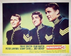 Pictured is a US lobby card for the 1962 John Sturges film Sergeants 3 starring Frank Sinatra, Dean Martin and Peter Lawford.