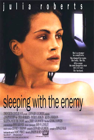 Pictured is a US promotional one-sheet poster for the 1991 Joseph Ruben film Sleeping with the Enemy starring Julia Roberts.