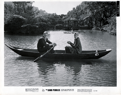 Pictured is a US black-and-white promotional still photo for the 1966 Robert Wise film The Sand Pebbles starring Steve McQueen and Candice Bergen.