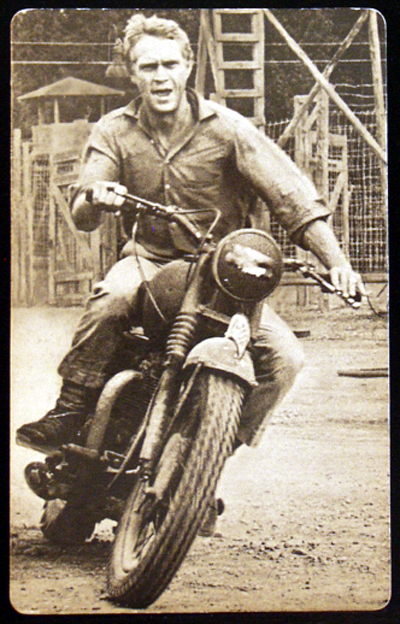 Pictured is a US commercial postcard with a photo of Steve McQueen from the 1963 John Sturges film The Great Escape starring Steve McQueen.