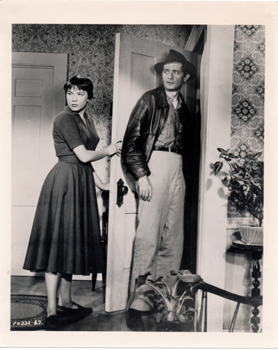 Pictured is a US promotional still photo from the 1955 Alfred Hitchcock film The Trouble with Harry starring Shirley Maclaine.