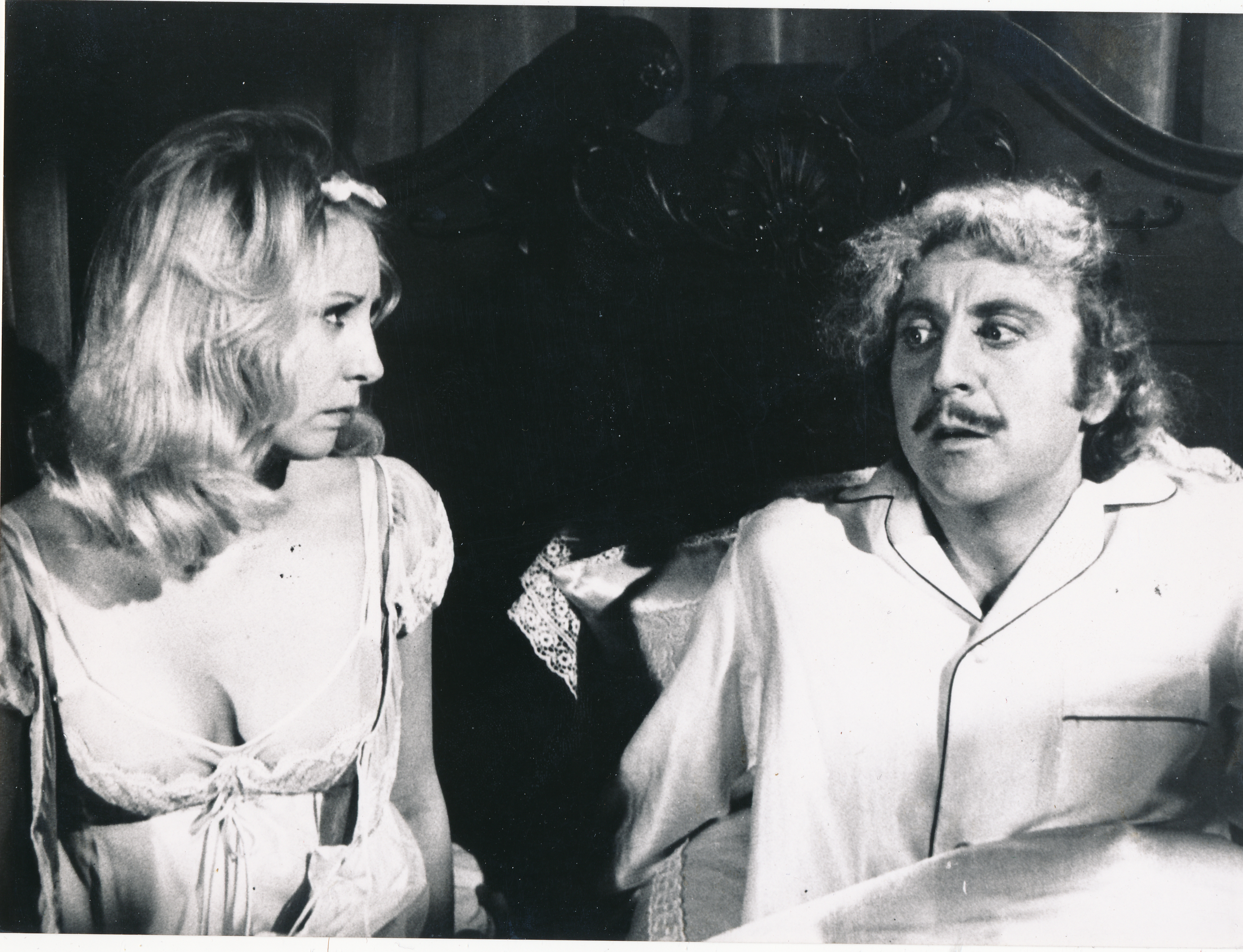Pictured is a black-and-white still for the 1974 Mel Brooks film Young Frankenstein starring Gene Wilder and Teri Garr.
