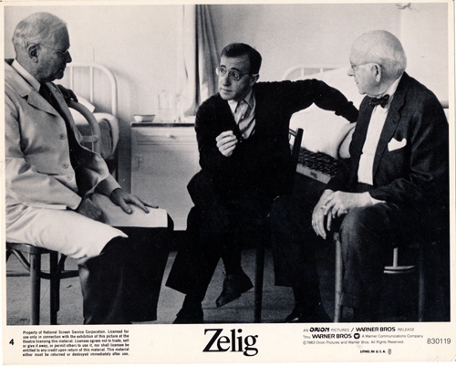Pictured is a US promotional 8x10 black-and-white lobby card from the 1982 Woody Allen film Zelig starring Woody Allen.