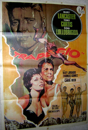 Pictured is a Spanish promotional poster for a 1973 rerelease of the 1956 Carol Reed film Trapeze, starring Burt Lancaster, Tony Curtis and Gina Lollobrigida.